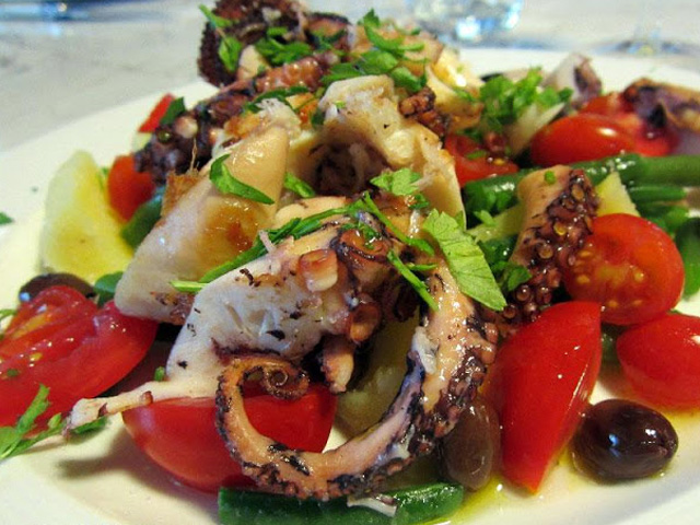 Octopus salad with cherry tomatoes and potatoes